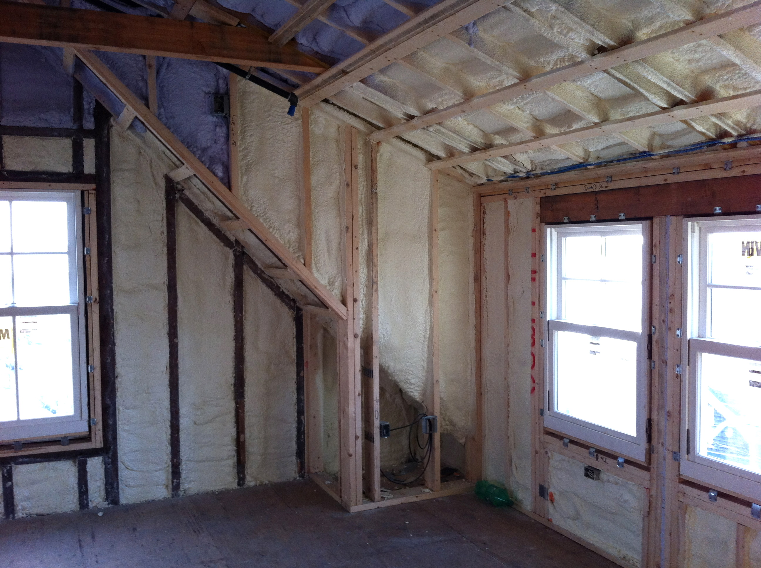 Open cell foam insulation on the top floor of the Woods Hole Inn, under construction.