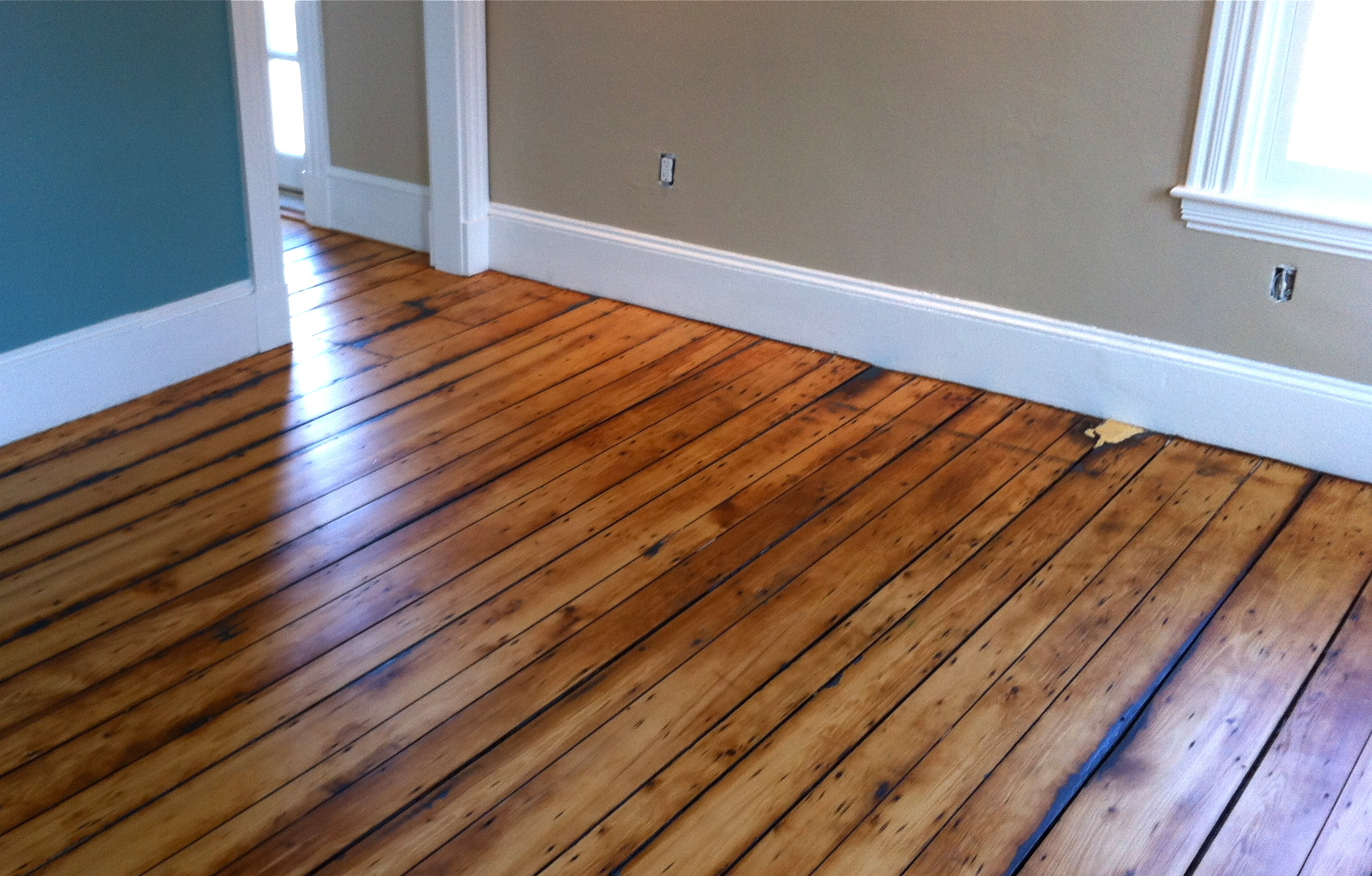 Shiny and new restored hardwood floors on Cape Cod.