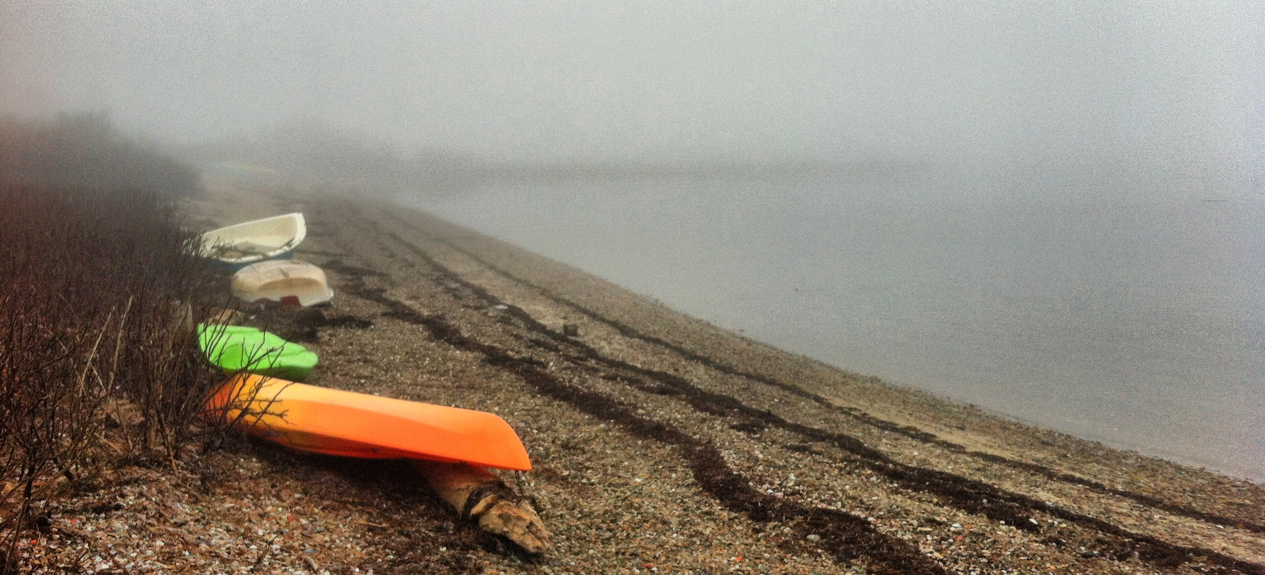 Orange kayak on the edge of the beach in Woods Hole