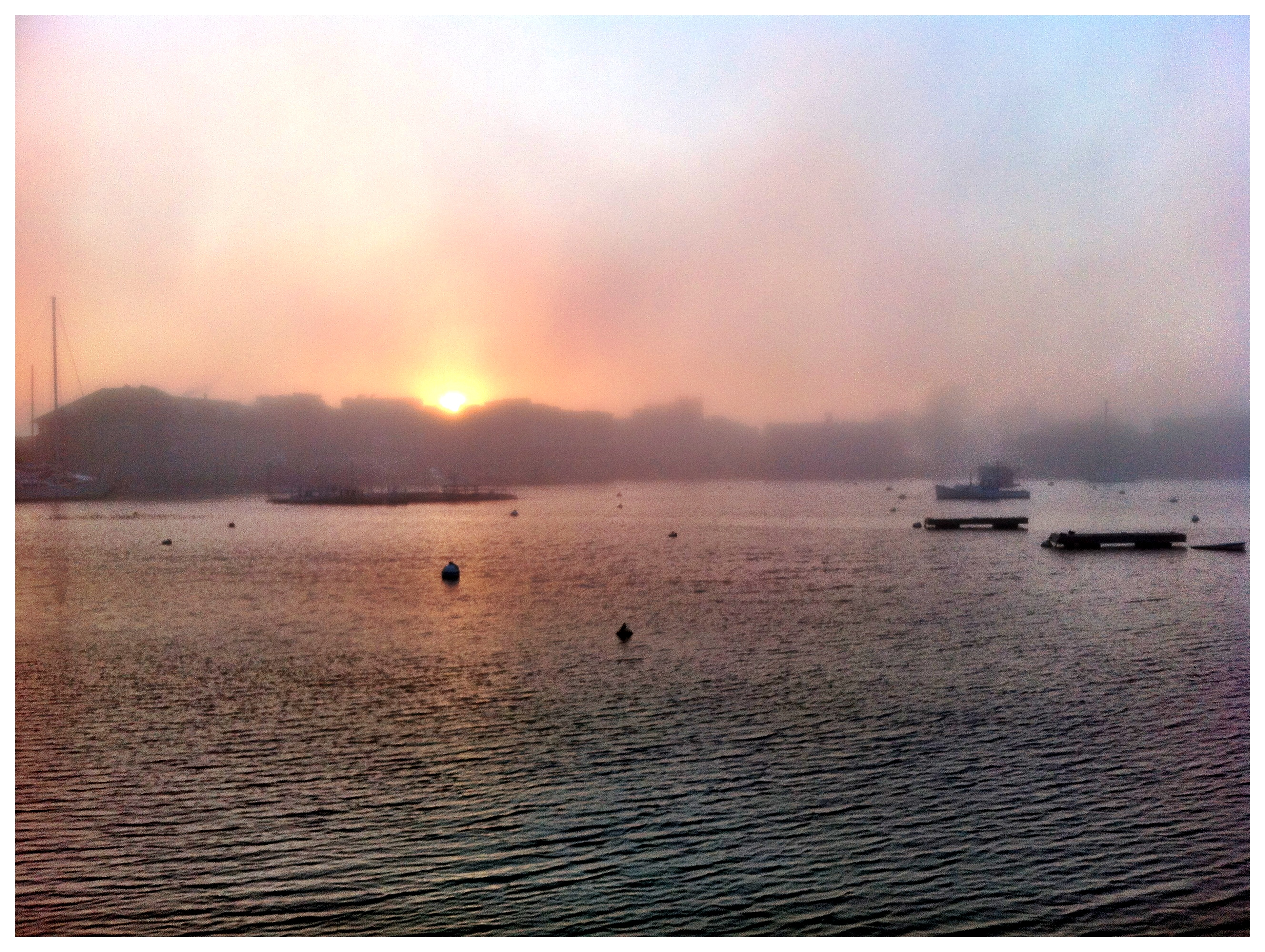 Sunset over the Eel Pond in Woods Hole in the fog.