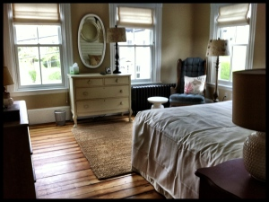 Vintage restored king room at the Woods Hole Inn.