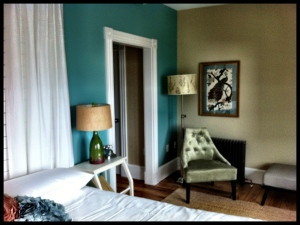 Blues and greens restfully dominate in this water view room at the Woods Hole Inn.