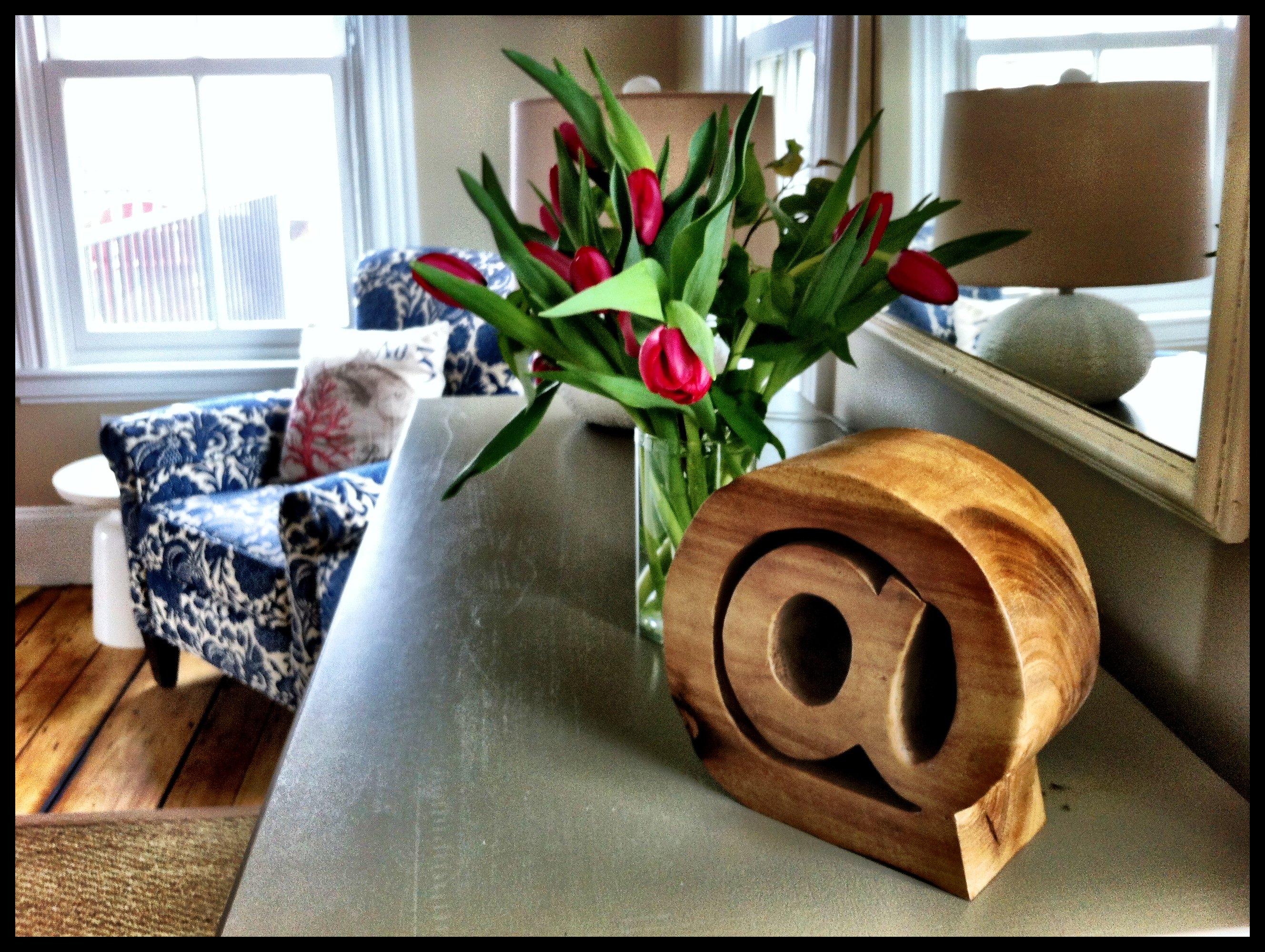 Views of the harbor and a private deck in this sunny corner room at the Woods Hole Inn.