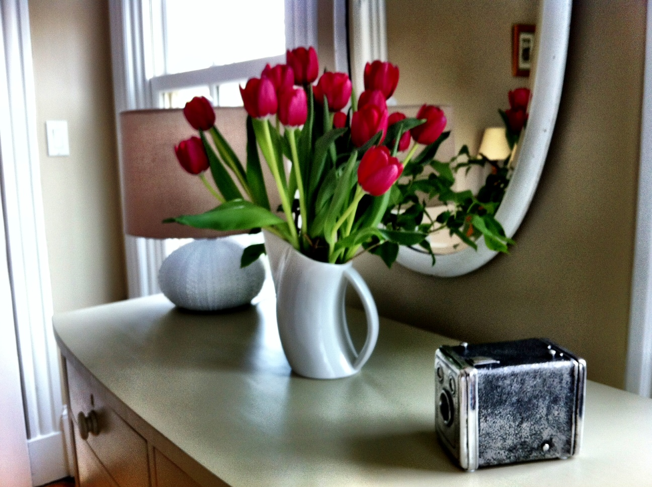 Romance starts with red tulips and clean modern design on Cape Cod.