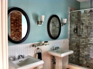 Marble tile shower and vintage exposed brick.